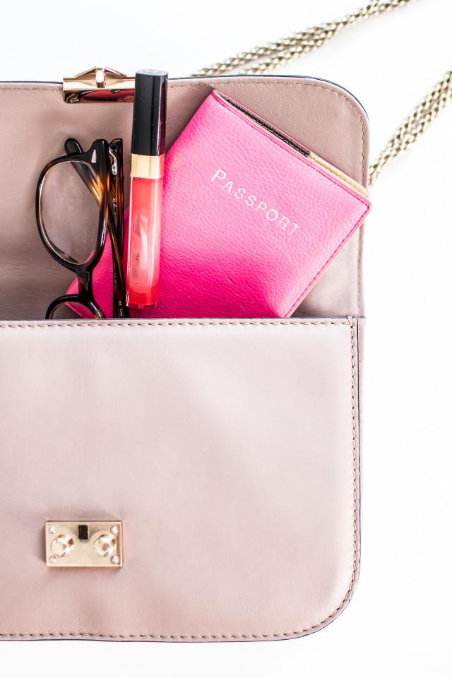 VIDEO: what's in my Valentino medium lock bag | Bikinis & Passports