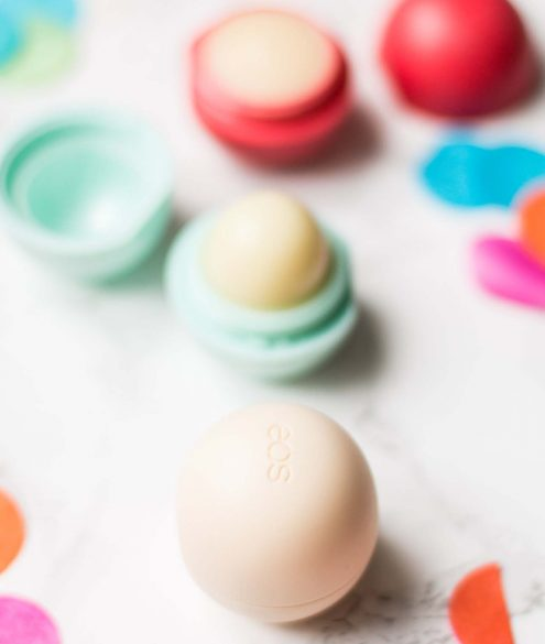 5 Beauty Products Worth Re-Buying: eos lip balm vanilla bean | Bikinis & Passports