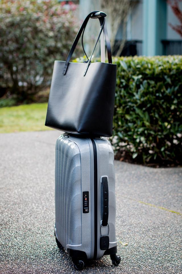 OUTFIT: Mansur Gavriel black shopper tote - Farfetch | Bikinis & Passports