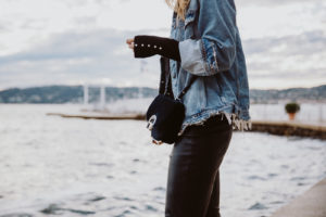 "Won Hundred Oversize Distressed Denim Jacket: Won Hundred Dina is a denim jacket with a ""boyfriend"" fit and a faded wash. 