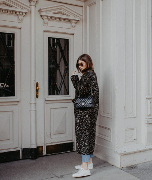 Outfit: long leo coat + Dior sneakers | Bikinis & Passports