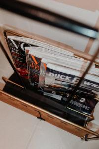 magazine rack: restroom decor | Bikinis & Passports