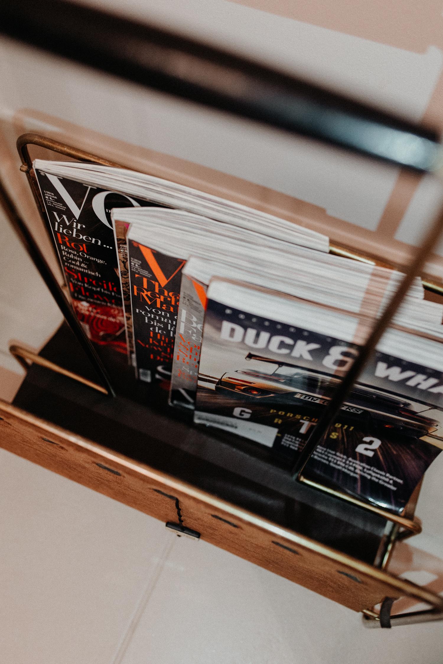 magazine rack: restroom decor   Bikinis & Passports
