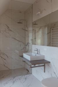 White Marble Bathroom | Bikinis & Passports