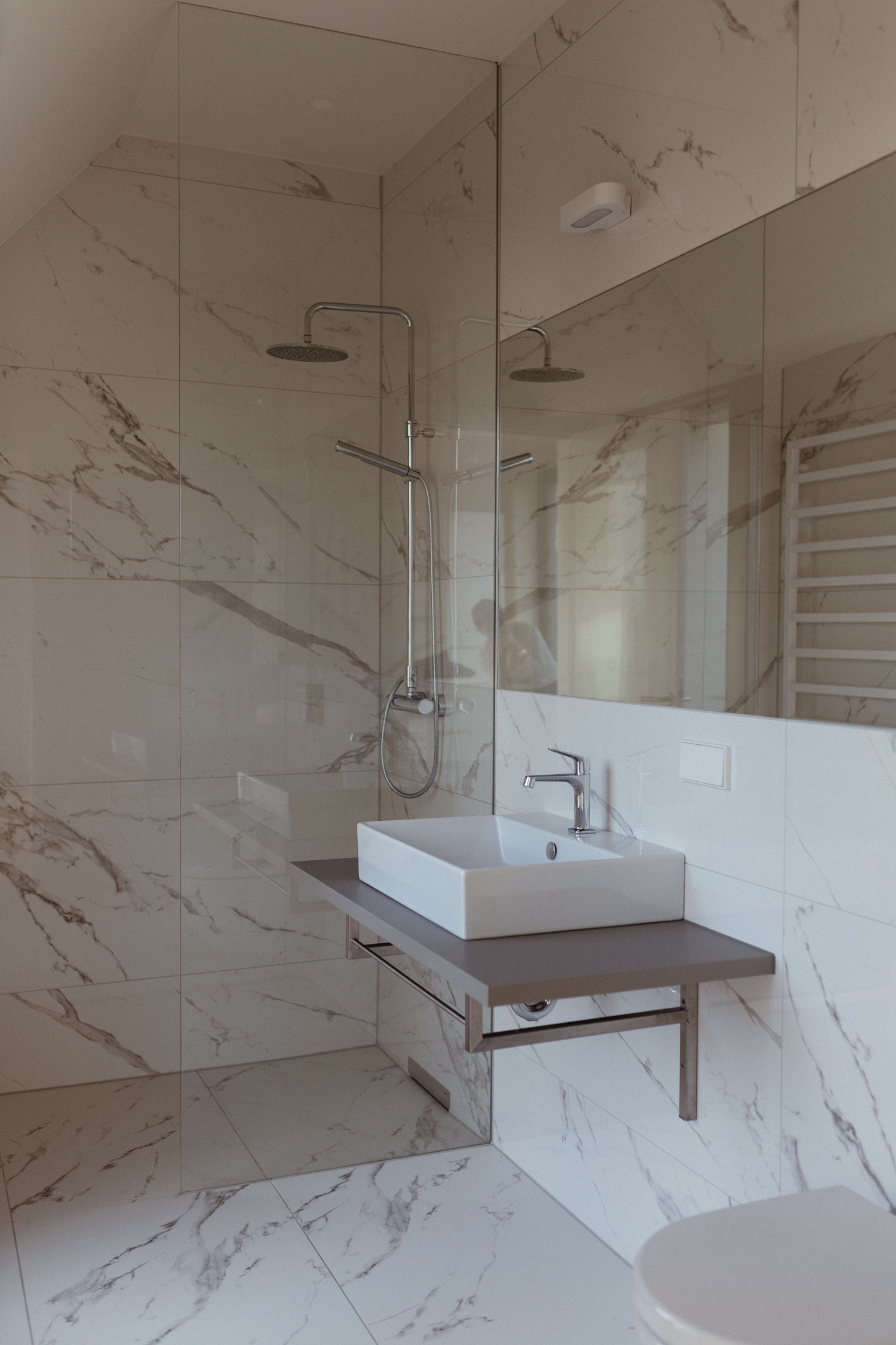 White Marble Bathroom | Bikinis & Passports
