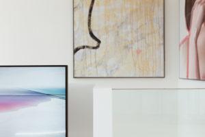 Vicky Heiler Apartment, Living Room: Samsung The Frame TV 55 inch - Bikinis & Passports