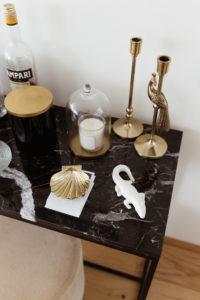 Vicky Heiler Apartment, Living Room: Black Marble House Bar - Bikinis & Passports