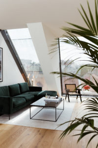 Vicky Heiler Apartment, Living Room: Green Velvet Sofa - Bikinis & Passports