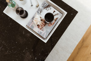 Vicky Heiler Apartment, Living Room: Black Marble Coffee Table Styling - Bikinis & Passports